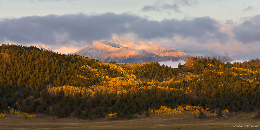 An early fall snowstorm on the Sawatch Range clears at daybreak outside of Buena Vista, Colorado.