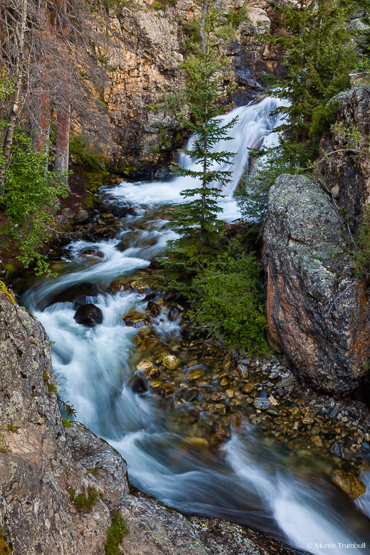The North Fork South Arkansas River tumbles down Shavano Falls and makes a sharp turn through a narrow rocky canyon in the San Isabel National Forest in southern Colorado.