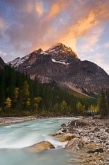 Sunset turns the skies pink above the Yoho River in Yoho National Park, British Columbia, Canada.