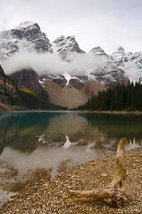 The waters of Moraine Lake are calm after a morning shower at Banff National Park in Alberta, Canada.