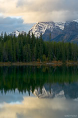 The peaks of the Bow Range reflect in Herbert Lake at Bannf National Park, Alberta, Canada.