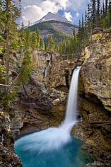 Stanley Falls drops into a turquoise pool on Beauty Creek in Jasper National Park, Alberta, Canada.