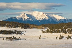 Clouds hang over Mt. Princeton in a winter scene at Bassam Park outside of Buena Vista, Colorado.