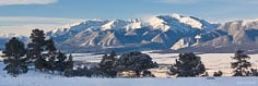 Snow blows off Mt. Antero on a brisk winter morning outside of Buena Vista, Colorado.