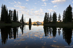 A beautiful sunrise is reflected in a pond on top of Paradise Divide outside of Crested Butte, Colorado.