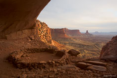 The False Kiva looks out over the canyon as the sun sets at Canyonlands  National Park outside of Moab, Utah.