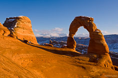 Delicate Arch with the snowy La Sal Mountains in the distance at Arches National Park outside of Moab, Utah.