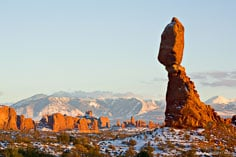 Balanced Rock seems to be standing guard over the La Sal Mountains and the other rock formations in Arches National Park outside of Moab, Utah.
