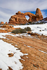 Turret Arch and the North Window on a sunny winter day in Arches National Park outside of Moab, Utah.