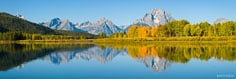 The calm waters at Oxbow Bend reflect the peaks of the Teton range in Grand Teton National Park, Wyoming.