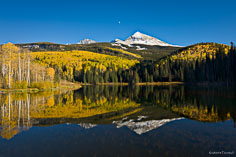 Golden aspens and snow-capped Wilson Peak is reflected in Woods Lake outside of Telluride, Colorado.