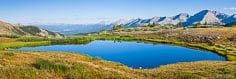 An alpine pond reflects the brilliant blue sky on Cottonwood Pass, above Buena Vista, Colorado.
