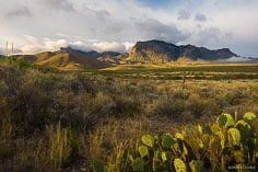 Clouds lift over the Chisos Mountains at sunrise in Big Bend National Park in Texas.
