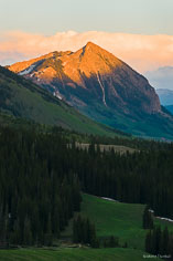 The last light of the day kisses the peak of Crested Butte outside of Crested Butte, Colorado.