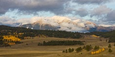 An early fall snowstorm on the Collegiate Peaks clears at daybreak outside of Buena Vista, Colorado.