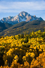 Vibrant fall foliage fills the valley below Mount Sneffels outside of Ridgway, Colorado.