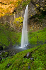 Elowah Falls flows over a wall into a moss surrounded pool in the Columbia Gorge, outside of Portland, Oregon.