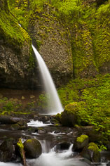 Ponytail Falls spouts out of a rock in the Columbia Gorge, outside of Portland, Oregon.