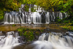 Multi-leveled Purakaunui Falls in the rainforests of South Island in New Zealand.