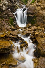 Middle Creek Falls flows at full force with water from melting snow pack outside of Crested Butte, Colorado.