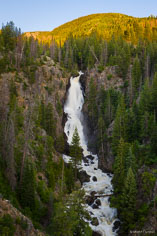 Early summer runoff plunges over Fish Creek Falls in Steamboat Springs, Colorado.