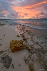 A gorgeous pastel colored sunrise over Merrywing Bay in Anguilla, BWI.