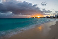 The setting sun shines its last light on Shoal Bay West in Anguilla, BWI.