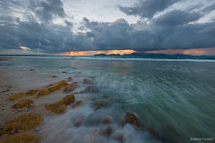A rmorning rain storm sweeps over the island of St. Martin as seen from Merrywing Bay in Anguilla, BWI.