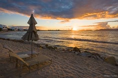 Lounge chairs invite you to sit down and watch the golden sunrise over Shoal Bay West in Anguilla, BWI.