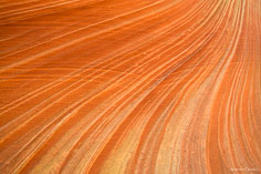 Flowing patterns in the red sandstone walls of The Wave in northern Arizona.