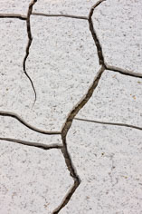A dried lake bed cracks from the desert heat in Death Valley National Park, California.
