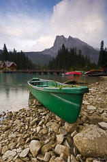 A canoe rests on the shore of Emerald Lake in Yoho National Park, British Columbia, Canada.