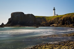 The Yaquina Head Lighthouse looks over a rocky bay along the Oregon Coast outside of Newport.