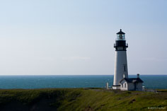 The Yaquina Head Lighthouse basks in the early morning light along the Oregon Coast outside of Newport.