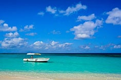 A glass bottom boat sits ready for the days crowd to arrive at lovely Shoal Bay in Anguilla, BWI.