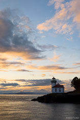 The Lime Kiln Lighthouse perches at the edge of the sea at the San Juan Islands in Washington.