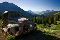 An old pickup truck sits at an old mine at the top of Washington Gulch outside of Crested Butte, Colorado.