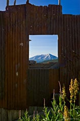 Whetstone Mountain is seem through the window of an old mine building outside of Crested Butte, Colorado.
