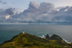 Cape Reinga Lighthouse stands watch over a stormy seascape at the northernmost point on the North Island of New Zealand.
