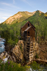 The Crystal Mill stands perched on a rock above a waterfall on the Crystal River outside of Marble, Colorado.
