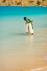 A fisherman looks for a target for his fish net at Crocus Bay in Anguilla, BWI.