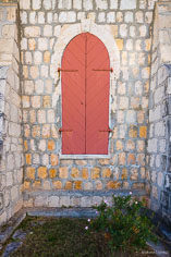 A shuttered window on the Bethel Methodist Church in Anguilla, BWI.