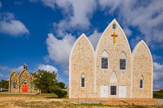 The new large St. Gerard's Catholic Church stands in front of the tiny old church it replaced in Anguilla, BWI.