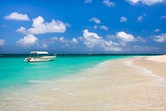 A glass bottom boat is anchored on the beach at Shoal Bay in Anguilla, BWI.