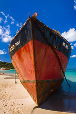 A ship named Mr. Ted takes on an ominous view on the beach at Road Bay in Anguilla, BWI.