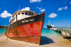 A grounded ship named Mr. Ted rests on the beach at Road Bay in Anguilla, BWI.
