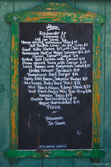A weathered menu is posted on the wall at the Pump House in Anguilla, BWI.