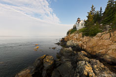 Beautiful blue skies and white clouds compliment the Bass Harbor Head Light in Acadia National Park, Maine.