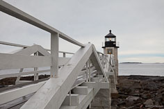 Marshall Point Light sits at the end of a walkway outside of Port Clyde, Maine.