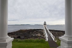 Marshall Point Light is seen from the porch of the lighthouse keeper's house outside of Port Clyde, Maine.